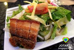bagnet salad (pork cracklings with lettuce, tomatoes, and shallots mixed with a calamansi-and-bagoong dressing)