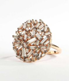 Suzanne Kalan rose gold Vitrine ring with champagne baguette diamonds ($5,000).