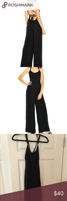 Rachel Roy black Jumpsuit Worn, wear visible on back ties (showed in photo) other than that beautiful jumpsuit with backless strapped detail. RACHEL Rachel Roy Dresses