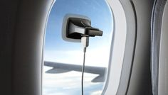 Perfect for travelling on long flights - solar powered charger + suction cup. Genius!