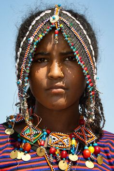 Afar people are found in Ethiopia, Somalia, Eritrea, and Djibouti. They are Muslim and are mostly a Nomadic people. Their language is part of the Cushitic family of languages which include Oromo, and Somali.
