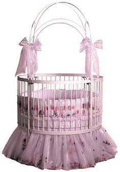 Talk about a princess baby bed! My baby girl will definitely have this!!