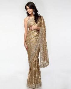 A golden sari is shown. This is an inspiration for what Regina George's dress would look like in an Indian society.