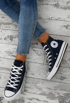 We all need a pair of high top Converse in our wardrobe and these are going straight onto our wishlist. These navy Converse All star trainers are such a classic style, featuring branding to the side and a rubber capped toe. Vans Sneakers, Sneakers Mode, Sneakers Fashion, Fashion Shoes, Teen Fashion, Fashion Ideas, Converse Fashion, Black Shoes Sneakers, Edgy Shoes