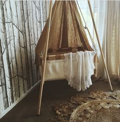 Beautiful sweet hanging cradle by Kindekeklein styled with Armadillo & Co marigold rug Photo by @sophie.vine