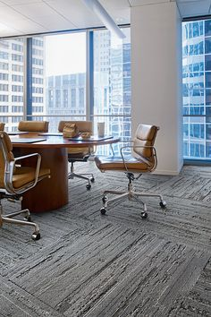 Ceremony Collection | CE173 | Color: Samurai in conference room / meeting room. This particular design was arranged in different directions to add dimension to the space and emphasize the linear pattern in the carpet. Interior floor designs for collaboration spaces.