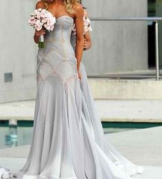 Beautiful flowy wedding gown in off-white... Would never wear the color but this dress is so pretty anyway
