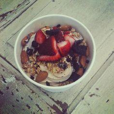 Frozen yogurt with almonds, strawberries, cookies, and granola #natilove