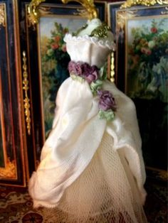 1:12th scale dolls house Couture Miniature Dressed Mannequin Wedding/Opera Gown. £29.00, via Etsy.