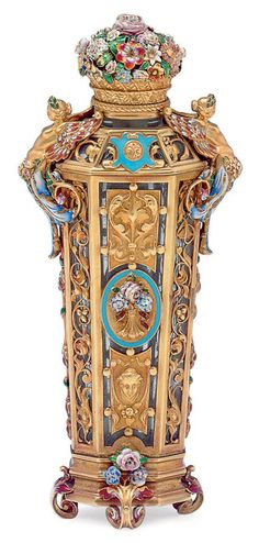 A FRENCH ENAMELLED AND GOLD-MOUNTED GLASS SCENT FLASK PARIS, CIRCA 1860, MAKER'S MARK A OVER ? Tapering octagonal, the glass body applied with openwork gold panels, the hinged flowerbasket cover concealing a cylindrical gold stopper,