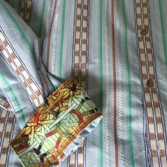 Robert Graham shirt size Lg worn once $65 Authentic Men's Robert Graham shirt. Button-down long sleeve. Different print on the shirt and the sleeves. Size LG. Excellent condition...Worn once. Originally $185. Great for work or Night on the town. Exclusive and expensive, Woven conservative stripe print, color mostly light blue verticals stripes with inner designs. Has all buttons and great quality. Very comfortable. Please feel free to ask any questions. Robert Graham Tops Button Down Shirts