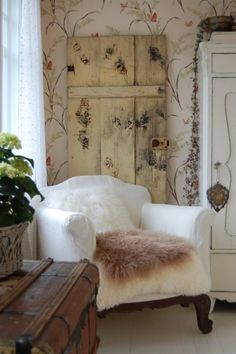 I love leaning an old door against a wall, I just did this in my den and it adds some depth and coziness.
