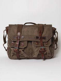 Rugged, hardwearing, and good looking - Polo Ralph Lauren gives us a prime example of the perfect men's bag. With obvious military references, this Ralph Lauren messenger bag is made from thick, washed canvas, with vintage leather trim and straps, slightly tarnished hardware, and features two button pockets on the front and one on the inside. $261.00