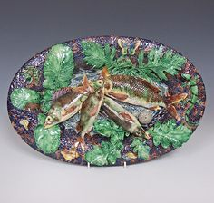 A very fine quality exquisitely decorated French oval Palissy charger, liberally bestrewn with raised and finely moulded foliage, with a profusion of beautifully coloured and detailed fish to the central well. French c 1870  Dimensions in Inches: L: 16.5 ins W: 11 ins