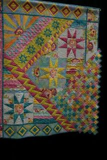 """This looks like the quilt pattern """"I Give You the Sun, the Moon, the Stars"""" by Jane Wells from the book Beyond the Block. Love this interpretation!"""