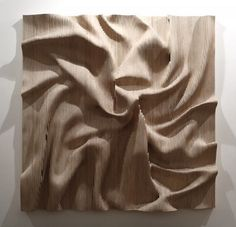 The work of Korean artist Cha Jong-Rye looks like anything but wood.  Her large pieces hang on the wall as if they were draped cloth, strange liquids, and geological formations.  Her peculiar choice of medium undoubtedly references these and other ideas of nature and the home.  She painstakingly carves her work from wood, often from hundreds of small pieces.  She seems to crumple, pinch, and pull a material that's especially rigid, typically found as a tree or house.