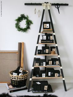 A little late getting an advent calendar? A PS 2014 wall shelf can easily be turned into one with some boxes and numbered paper. Ikea Christmas, Christmas On A Budget, Simple Christmas, Christmas And New Year, Christmas Time, Christmas Crafts, Ikea Ps 2014, Seasonal Decor, Holidays Events