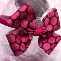 """Brown & shocking pink hair bow on 3/8"""" plastic headband.   Can find on my Giggly Girl Bowtique Facebook page!"""
