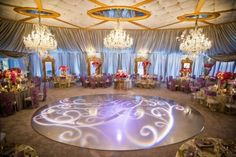 Glass Dancefloor | E! Entertainment Bridalplasty Celebrity Wedding | Wildflower Linen Chair Covers and Table Linens | Events by Design |www.baumanphotographers.com www.baumanphotographers.com