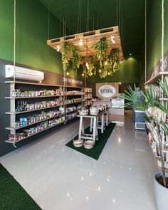 This Natural Foods store has sectioned off areas of tile and fake grass, the whole space promoting a natural feel to match their merchandise. Cafe Design, Store Design, Interior Design, Pharmacy Design, Retail Design, Eco Store, Cosmetic Shop, Store Interiors, Retail Interior