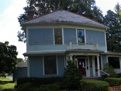 This beautiful Victorian style 2.5 story home has 5 bedrooms and 2 full baths. 4 of the bedrooms are on the second floor with the 5th on the top half story. There are 6 fireplaces 3 of which are in 3 of the bedrooms with the remaining 3 in the living room dining room and family room. If 5 bedrooms isnt enough space theres additional space in the partialbasement for storage. This huge home also has a 2 car attached garage and huge room sizes with hardwood flooring.