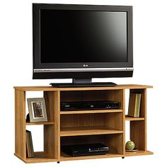 Accommodates up to a 42 in. TV weighing 70 lbs. or less.  Two large adjustable shelves hold audio/video equipment.  Two small adjustable shelves.  Cord management system.  Highland Oak finish.