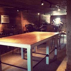 worktable - 4x4s for legs, 2x4s for table apron, plywood top, plumbing dept. rails. LOVE IT.