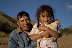 In Bolivia, Herman Almendras-Jaldin and daughter Yoselin enjoy eggs from the five chickens they received from Heifer International.