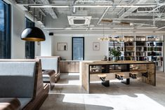 DRAFT Inc. has completed the design of their offices located in Osaka, Japan. The design uses the same furniture and materials as the Tokyo head office Commercial Design, Commercial Interiors, Booth Seating, Osaka, White Walls, Space Saving, Furniture Design, Offices, Lounge