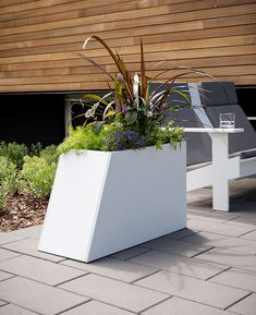 The many planter options of Tessellate can help to define a space, add unique lines, and of course, a pop of color. Designed by Ive Haugeland, Tessellate arrangements make a design statement. Ive created a modular and expandable planter system with four styles of varying heights and widths, giving you the creative license to play with shape and color #Loll #LollDesigns #recycledplastic #outdoorfurniture #sustainablefurniture #modernoutdoorfurniture #outdoorliving #planters #outdoorplanters Sustainable Furniture, Modern Outdoor Furniture, How To Clean Furniture, Outdoor Planter Boxes, Square Planters, White Sky, Recycled Materials, Shades Of Green, Light Colors