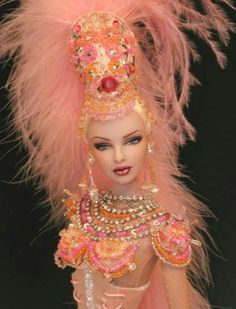 No info on origin of photo. It was posted on Pnterest.  Whoever the OOAK designer is, has some very lovely details in this outfit. I am thinking this is a Vegas Style Costume. Beautiful!
