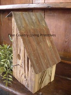 Handcrafted reclaimed barnwood and rusty tin roof birdhouse. Made in the USA.