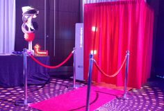 The classic photobooth with red carpet and bollards as standard of course! Don't forget the selection of props and complimentary guest book too.