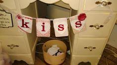 """Kiss"" Banner from Something Sweet Vintage Boutique in Kansas City. www.Facebook.com/somethingsweetkc"
