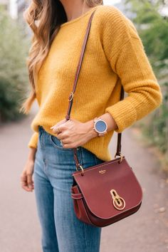 """Outfit Details: Sezane Sweater, Jeans & Booties, Mulberry Bag (similar here), Chanel Lip Stain in """"Soft Rose"""",Michael Kors Watch  We've been spending quite a bit of time in NYC, ..."""