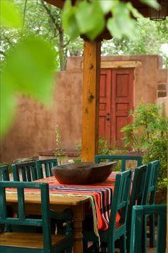 nice courtyard table. great use of color. also like the portal doors. maybe we could have one leading to the grounds outside the courtyard and home.