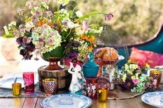 My style of wedding table decor. Very Bohemian and colorful and somewhat natural.