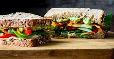 This mile-high vegetable and hummus sandwich makes the perfect heart-healthy vegetarian lunch to go. Mix it up with different flavors of hummus and different types of vegetables depending on your mood. Hummus Sandwich, Veggie Sandwich, Vegetarian Lunch, Vegetarian Recipes, Healthy Recipes, Sloppy Joe, Quesadillas, Lunch Recipes, Cooking Recipes
