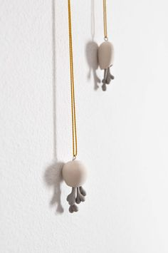 minimalist pod pendant with multiple hearts