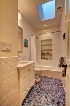 Building in shelves in a kids bath.  Great idea for toys