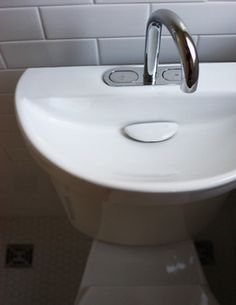 Tiny Bathroom Design Idea...hand washing gray water becomes the flush water for the toilet.