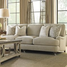 Indulge in a quiet evening of relaxation or offer your guests a sumptuous seat with this lovely sofa, featuring ultra-down cushions and elegant nailhead trim...