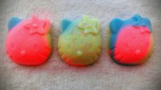 PRE ORDER ONLY.  READY TO SHIP Feburary 15TH. Fun mini soaps for the kids! Fruit Loops mini Kitty soaps.  You get 3 soaps.  They are 1.5 each.  About 2 inches tall and wide.  Handmade Soap made with coconut oil, olive oil, palm oil, water, lye, aloe oil, mineral mica powder (color), and lavende...