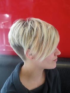 Blonde pixie with long bangs, buzzed back. *i think it needs a better blend from the buzz to the hair but otherwise very cool!