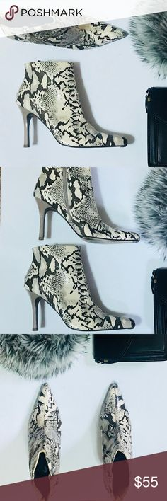 VINTAGE SNAKE SKIN Ankle Zip Boot Size 11 VINTAGE SNAKE SKIN Ankle Zip Boot Size 11. Faux snakeskin print boot. Point Toe. Slim heel. 3in in height. Taupe heel. Wear and tear around the ankle circumference as shown in the pictures. Boot color is white/cream in person.   Size 11 Heel 3in. Vintage Shoes Ankle Boots & Booties