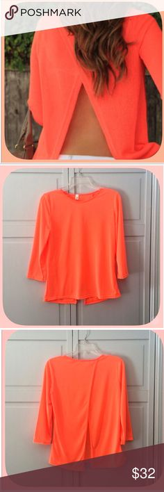 NWT Sexy Orange Lightweight Open Back Top This top is super sexy on! It is semi sheer a perfect piece for spring and summer! The color is absolutely beautiful! It is very versatile, wear with a cami or a cute bra! This a super cute top! Boutique Tops Blouses