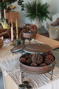 Hollyflora | GardenistaAntique Indian hot pots, perfect for a dinner party. Or pine cones.