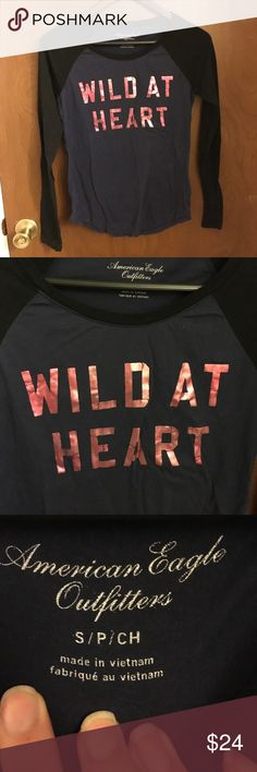 "Wild At Heart Baseball Tee American Eagle Outfitters Black & Dark Blue Baseball Tee Shirt with Metallic Pink Writing that says ""Wild At Heart"". Size Small. NWOT. ⚾️Please send reasonable offers through the offer button!⚾️ American Eagle Outfitters Tops Tees - Long Sleeve"