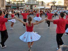 La sardana és una dansa popular catalana considerada el ball nacional de Catalunya. És una dansa col·lectiva que ballen homes i dones agafats de les mans formant una rotllana, i puntejant amb els peus els compassos de la música interpretada per la cobla. El nom pot fer referència tant al ball com a la música. L'origen de la sardana és desconegut.