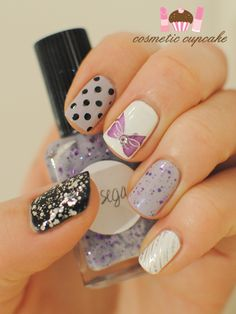 Pretty in purple manicure with bows and sparkles and polkadots